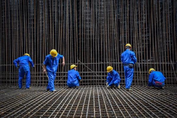 Foto: AFP / XINHUA / Liu Dawei / Radnici